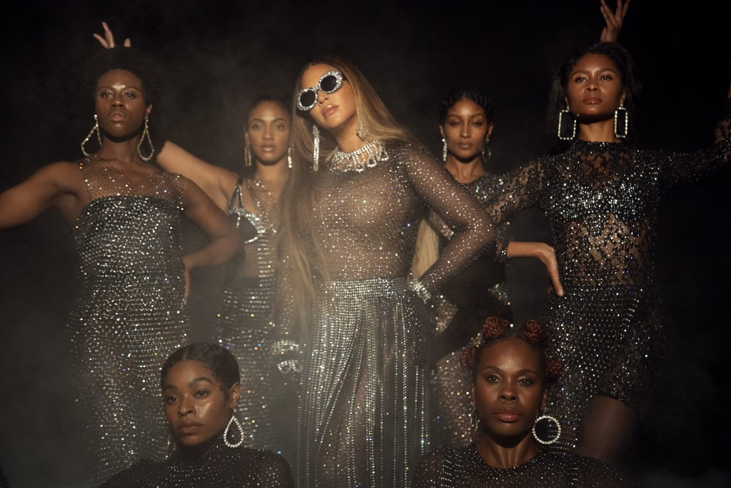 """This image released by Disney Plus shows Beyoncé in a scene from her visual album """"Black is King,"""" premiering Friday on Disney Plus. (Andrew White/Par..."""