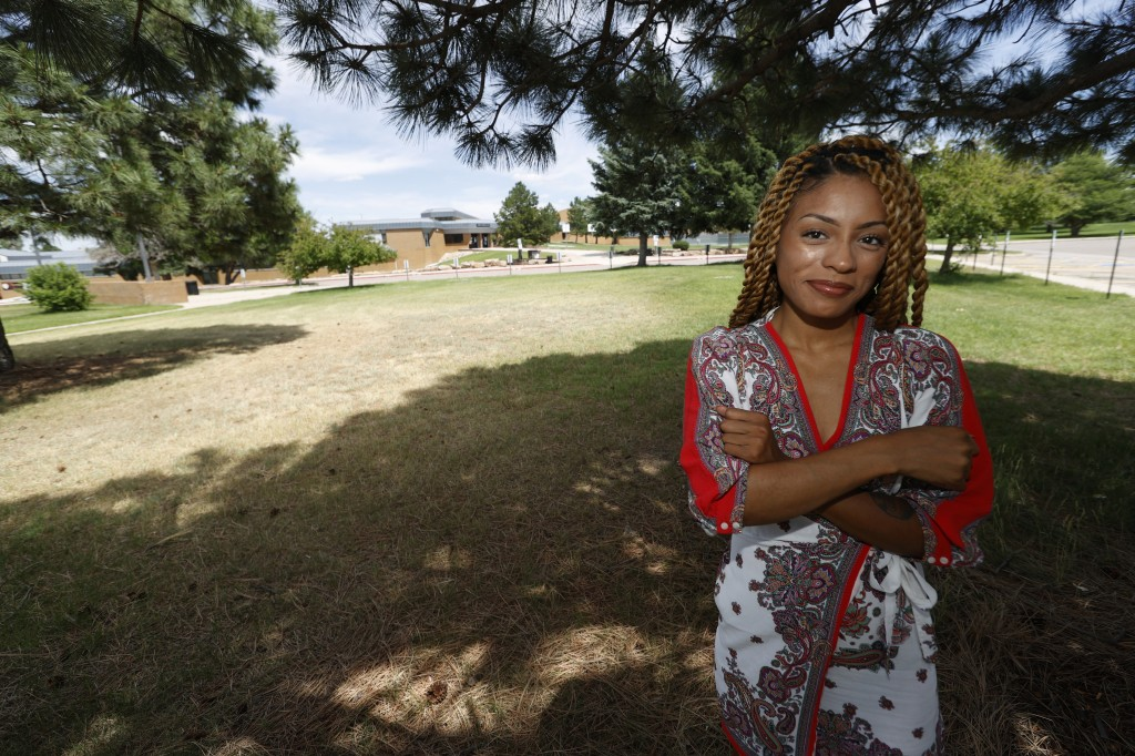 Tiera Brown stands outside Montbello High School in northeast Denver on June 22, 2020.  Brown, 28, who supported Denver schools' decision to phase out...