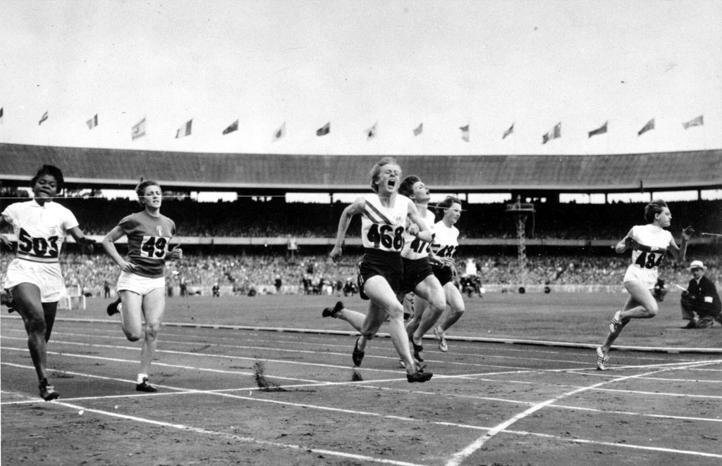 FILE - In this Nov. 26, 1956, file photo, Betty Cuthbert (468) of Australia runs past the finish line to win the women's Olympic 100 meters in Melbour...