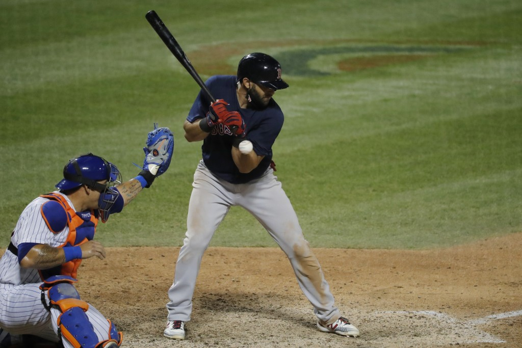 Boston Red Sox's Jose Peraza is hit by a pitch from New York Mets relief pitcher Edwin Diaz during the ninth inning of the baseball game at Citi Field...