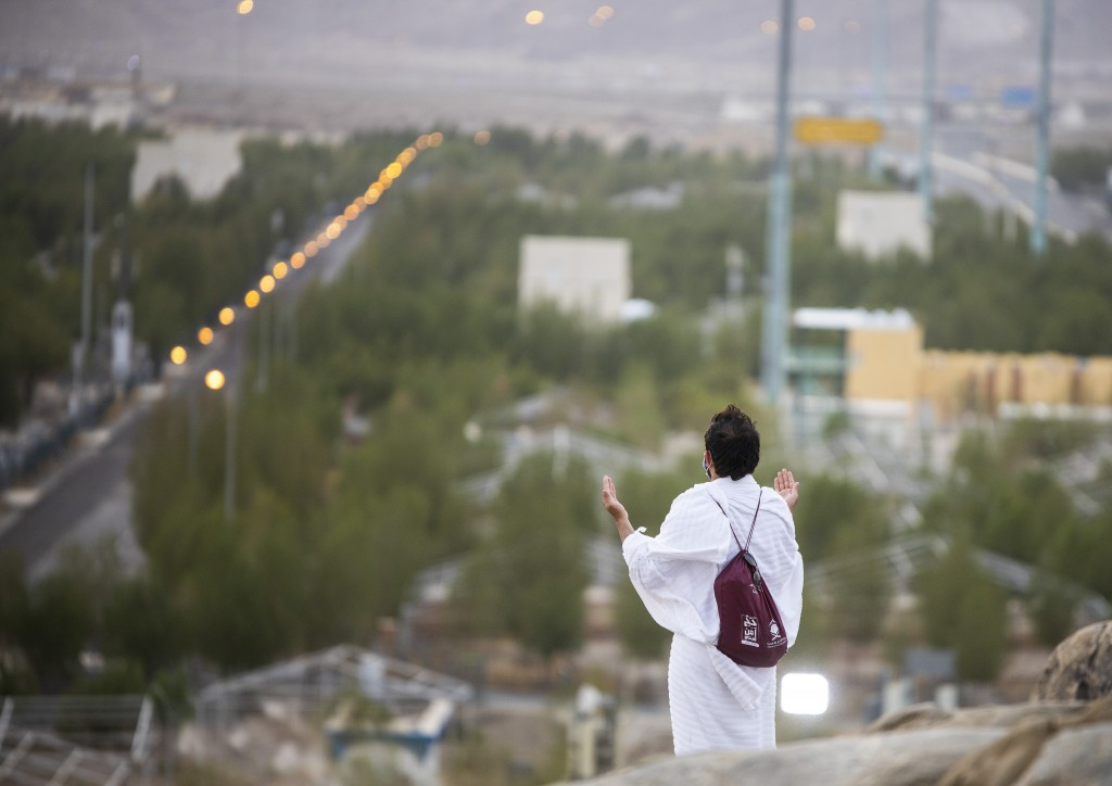 Muslim pilgrims pray on top of the rocky hill known as Mountain of Mercy on the Plain of Arafat during the annual hajj pilgrimage near the holy city o...