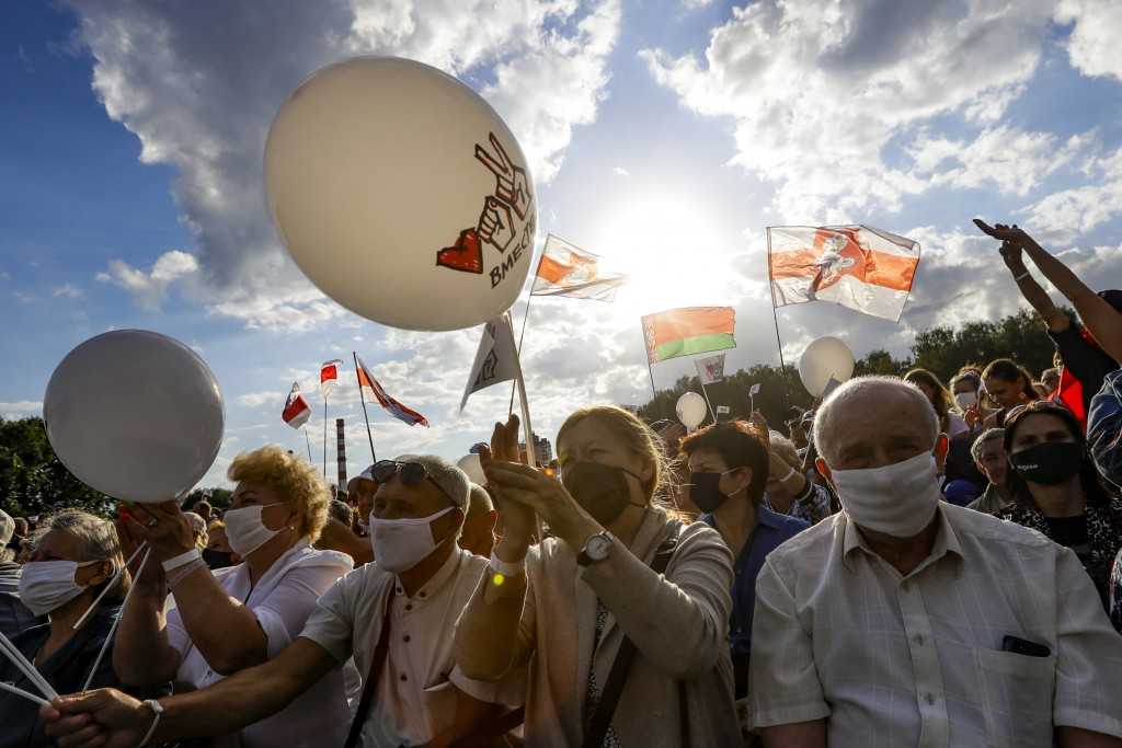 Belarusians wearing face masks to protect against coronavirus, attend a meeting in support of Svetlana Tikhanovskaya, candidate for the presidential e...