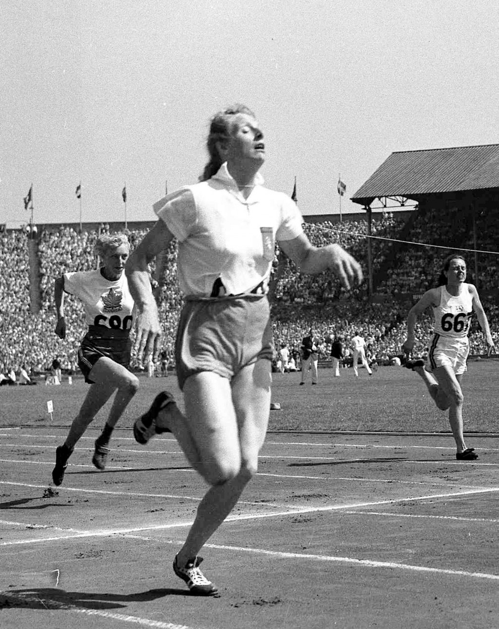 FILE - In this July 31, 1948 file photo, Fanny Blankers-Koen of Holland, foreground, wins heat one of the women's 100-metres Olympic Games competition...