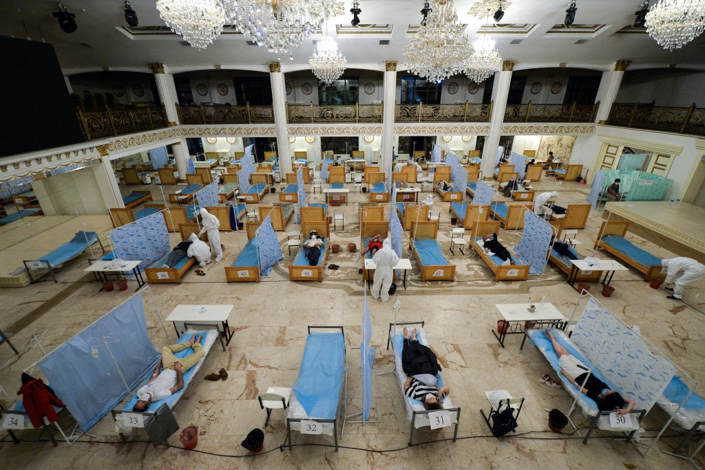 Patients suspected of having the coronavirus lie in beds set up in the hall of the Consul restaurant that was converted into a clinic in Bishkek, Kyrg...