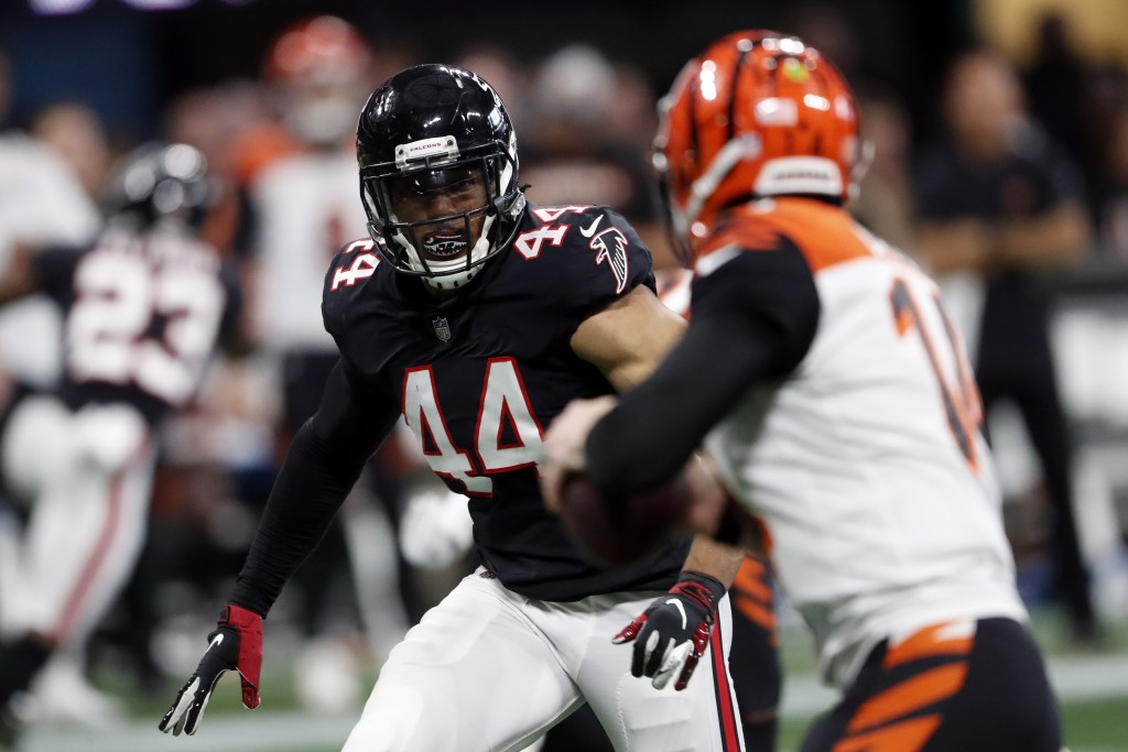 FILE - In this Sept. 30, 2018, file photo, Atlanta Falcons linebacker Vic Beasley (44) rushes against the Cincinnati Bengals during the second half of...