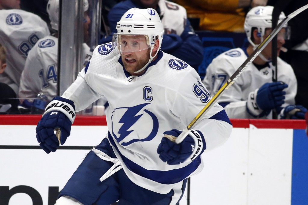 FILE - In this Feb. 17, 2020, file photo, Tampa Bay Lightning center Steven Stamkos (91) skates during the second period of an NHL hockey game in Denv...