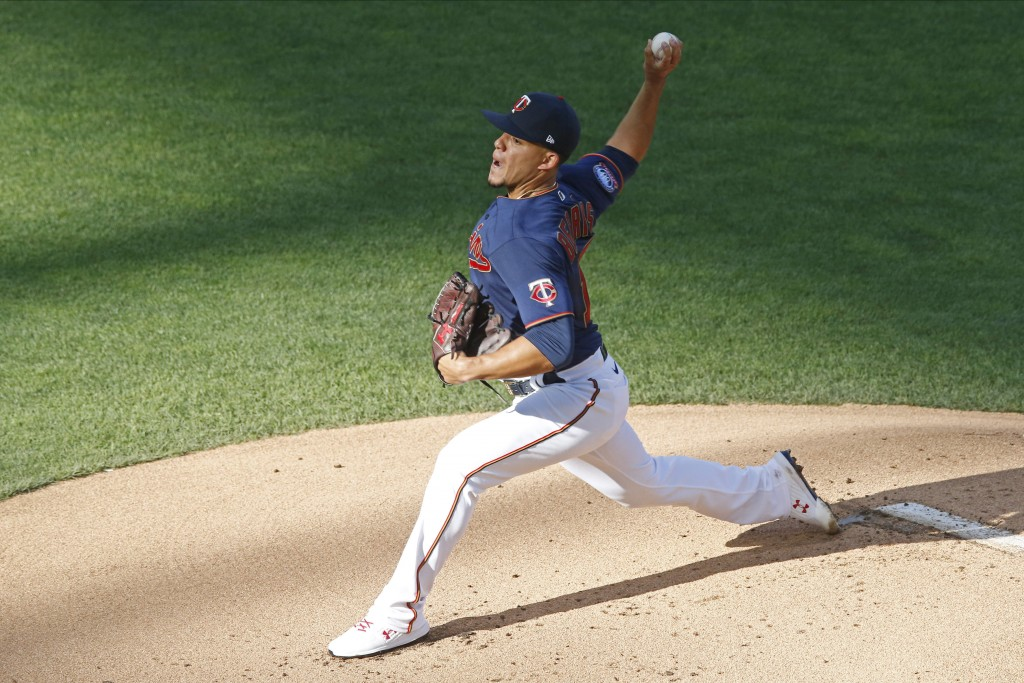 Minnesota Twins pitcher Jose Berrios throws against the Cleveland Indians in the first inning of a baseball game Thursday, July 30, 2020, in Minneapol...