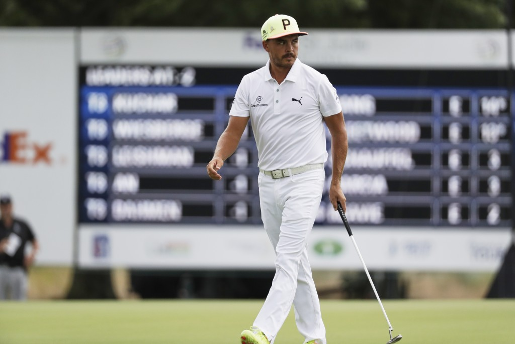 Rickie Fowler walks on the 12th green during the first round of the World Golf Championship-FedEx St. Jude Invitational Thursday, July 30, 2020, in Me...