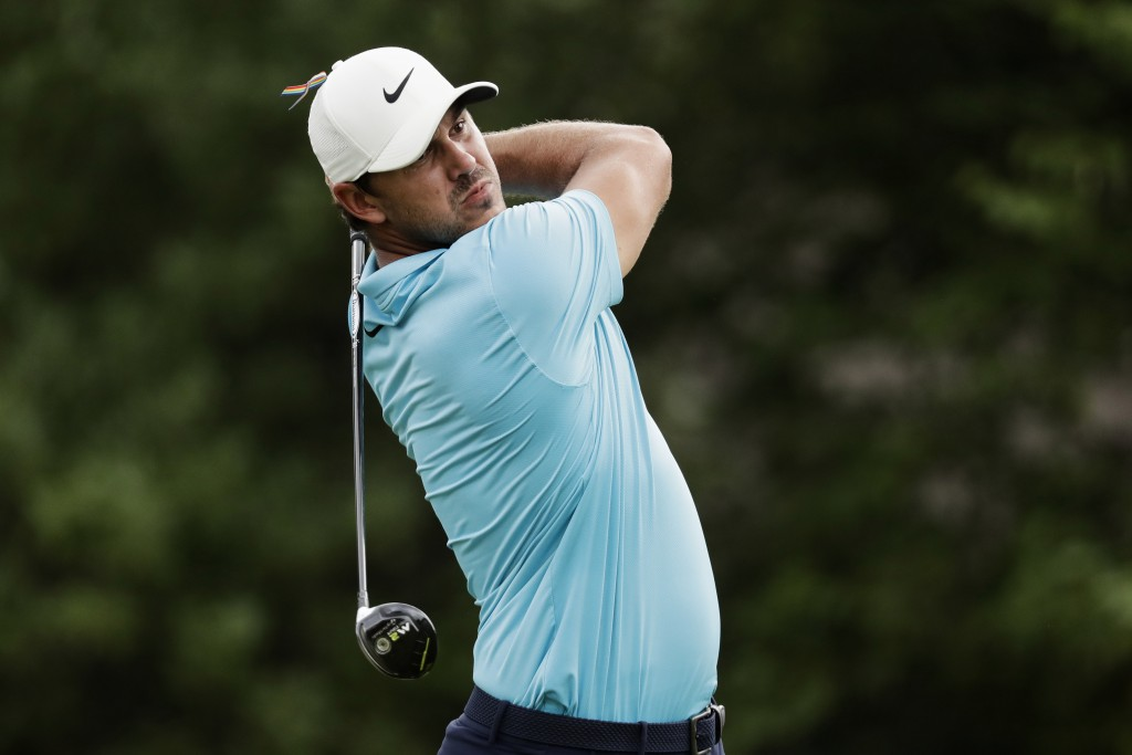 Brooks Koepka watches his tee shot on the 18th hole during the first round of the World Golf Championship-FedEx St. Jude Invitational Thursday, July 3...