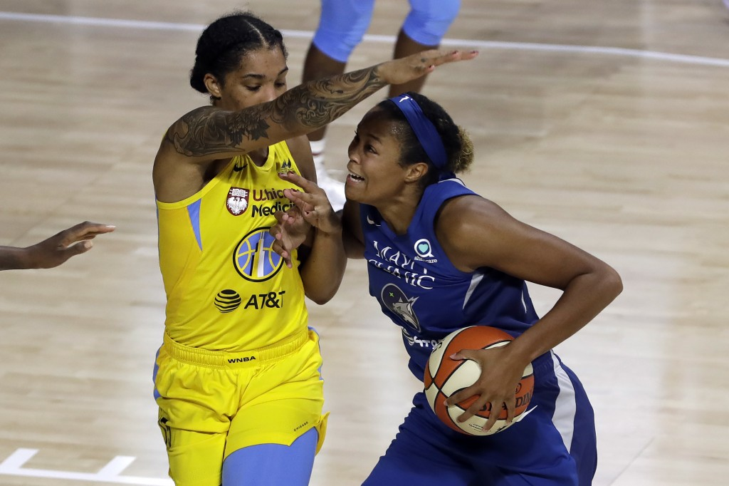 Minnesota Lynx forward Napheesa Collier, right, (24) gets fouled by Chicago Sky forward Gabby Williams (15) during the first half of a WNBA basketball...