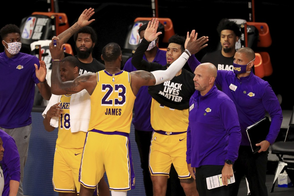 Los Angeles Lakers' LeBron James (23) celebrates with his teammates after they defeated the Los Angeles Clippers in an NBA basketball game Thursday, J...