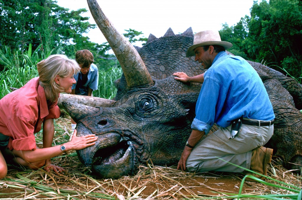 """This image released by Universal Pictures shows, from left, Laura Dern, Joseph Mazzello and Sam Neill in a scene from the 1993 film """"Jurassic Park."""" W..."""