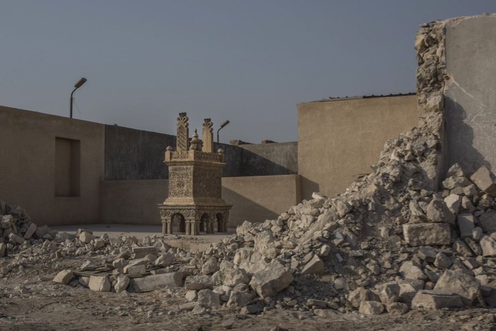 A tomb stands exposed after its walls were knocked down as part of construction of a new highway through the Northern Cemetery, part of the City of th...
