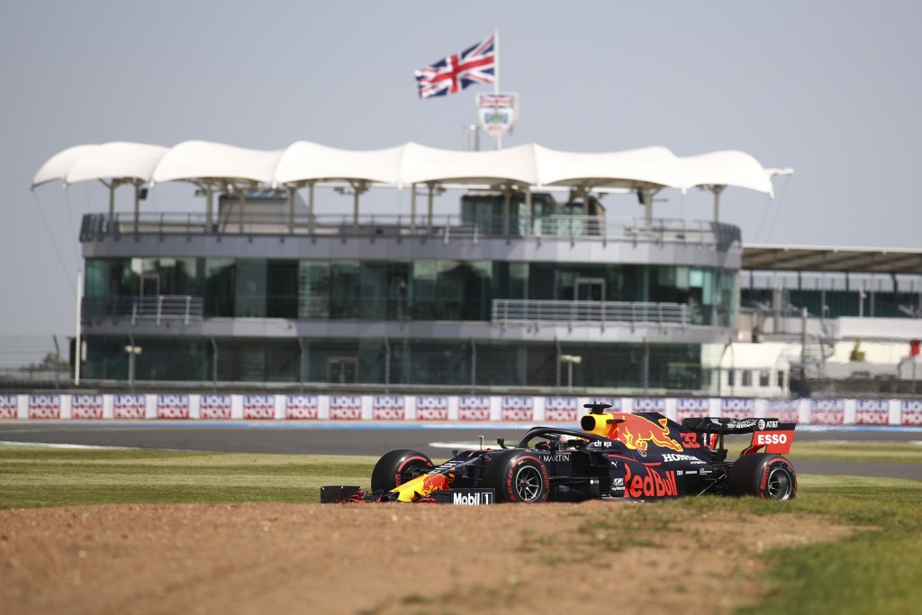 Red Bull driver Max Verstappen of the Netherlands steers his car during the first practice session for the British Formula One Grand Prix at the Silve...