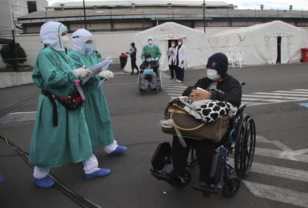 People who have tested positive for the new coronavirus are transferred to tents set up outside the Seguro Social hospital to continue their treatment...