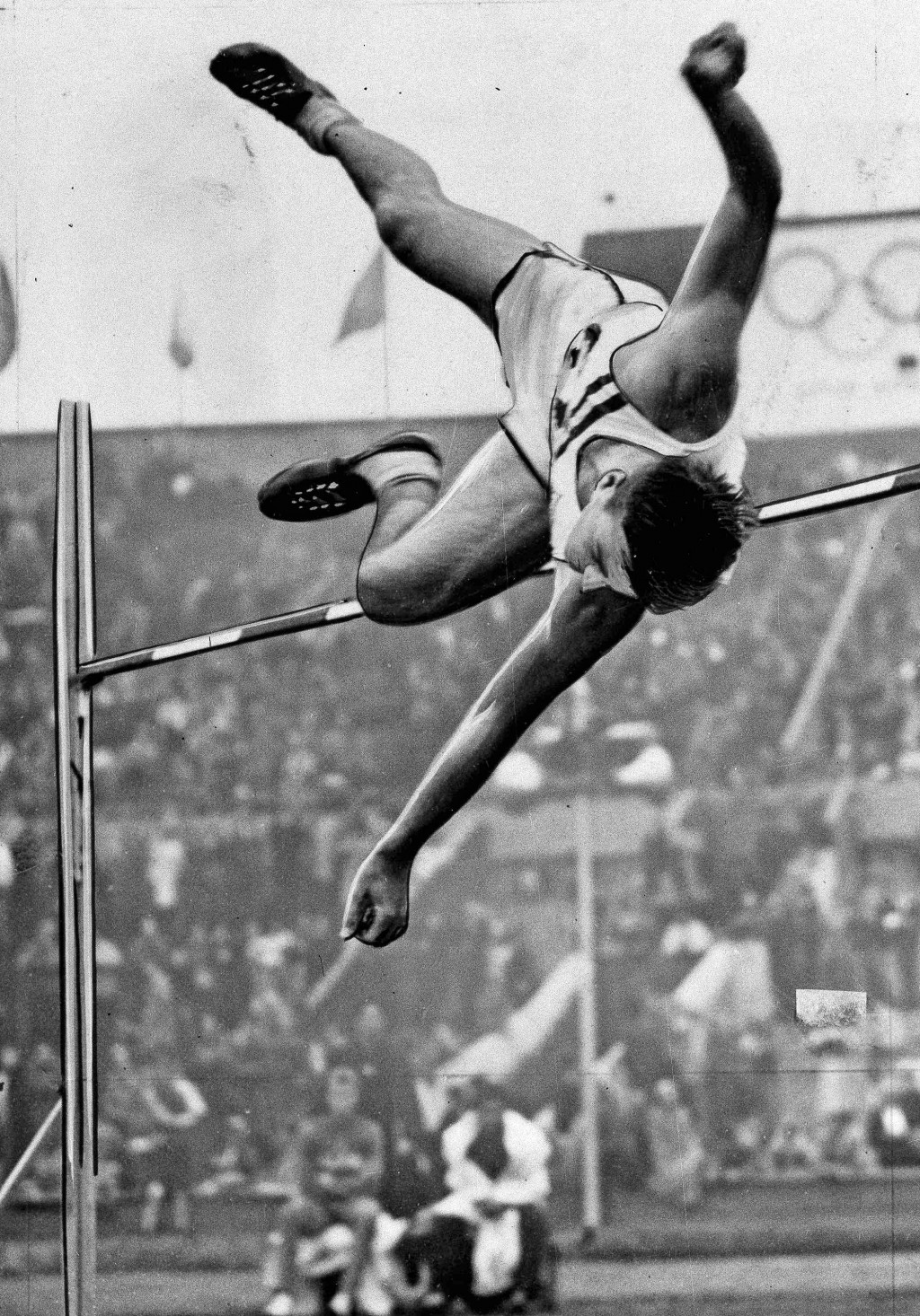 FILE - In this Aug. 5, 1948 file photo Bob Mathias of Tulare, Calif., clears the high jump bar at Wembley Stadium in London, in the decathlon competit...