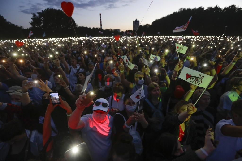 Belarusians attend a meeting in support of Svetlana Tikhanovskaya, candidate for the presidential elections in Minsk, Belarus, Thursday, July 30, 2020...
