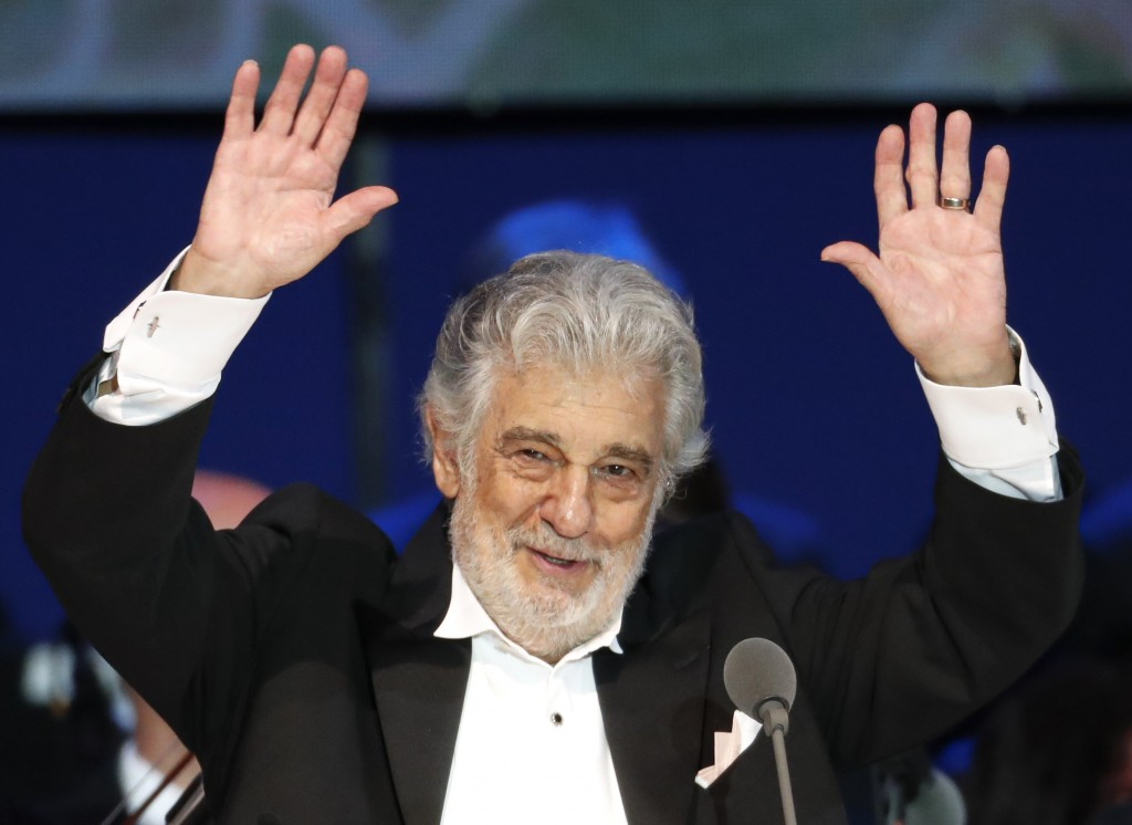 FILE- In this Aug. 28, 2019, file photo, opera singer Placido Domingo performs during a concert in Szeged, Hungary. Domingo will make his first public...