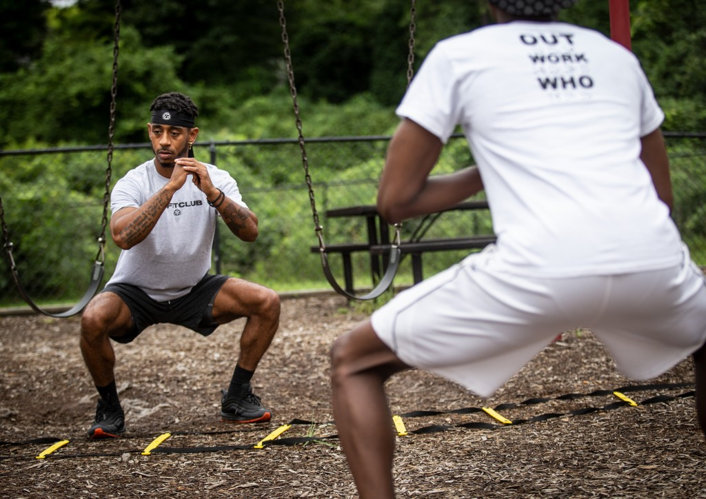 Sakai Harrison, left, leads his clients through a rigorous workout on Wednesday, July 29, 2020, in Atlanta. Harrison moved to New York to try to make ...