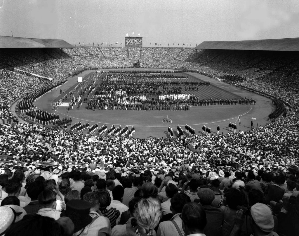 FILE - This July 29, 1948 file photo, showing the opening ceremony of the 1948 Olympic Games at Wembley Stadium, in London, England. London was still ...