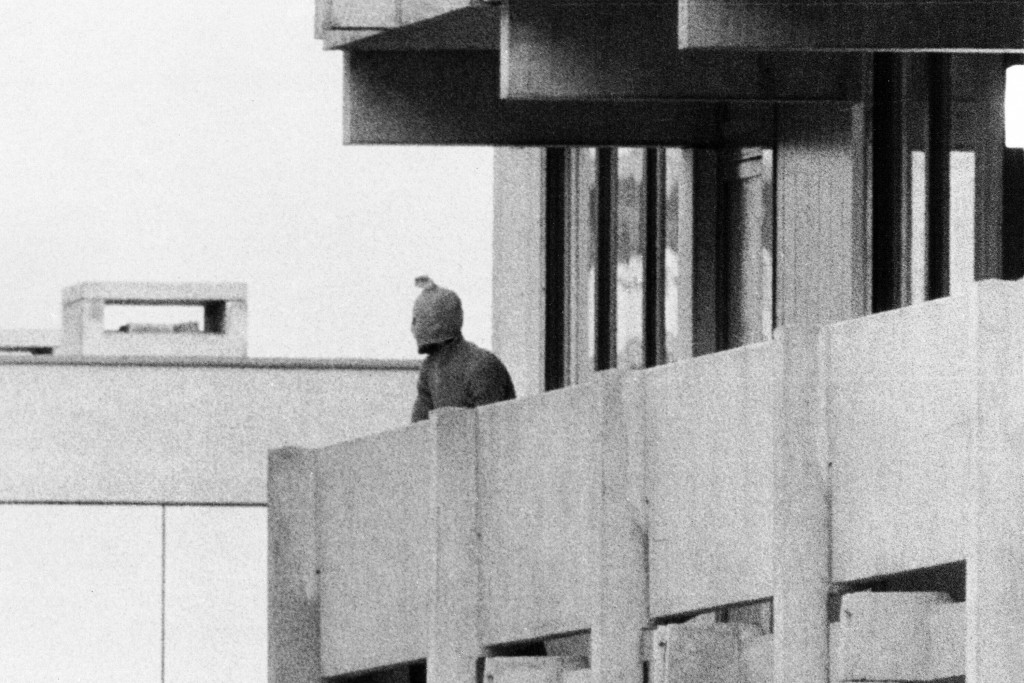 FILE - On Sept. 5, 1972, a Palestinian commando group seizes the Israeli Olympic team quarters at the Olympic Village in Munich, Germany. A member of ...