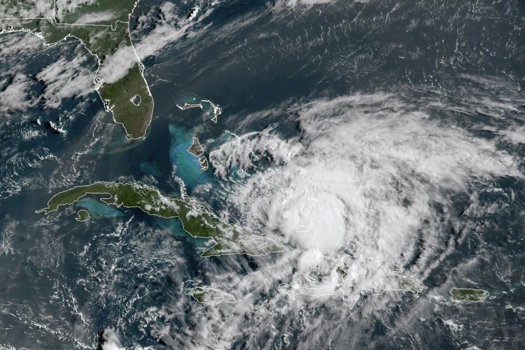 In this GOES-16 satellite image taken Friday, July 31, 2020, at 8:40 a.m. EDT., and provided by NOAA, Hurricane Isaias churns in the Caribbean. Hurric...
