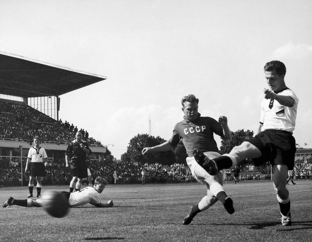 FILE - In this Nov. 24, 1956, file photo, German inside right Rolf K. Geiger, right, gets the ball past a Soviet defender during the Germany vs Russia...