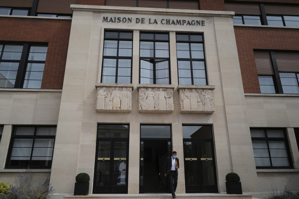 Thibaut Le Mailloux of the Champagne Committee, an organization that represents some 16,000 winemakers and 300 Champagne houses, walks out the Champag...