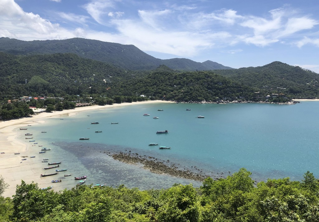 Fishing vessels and boats used to ferry tourists sit idle along a deserted beach on the popular tourist island of Koh Phangan, Thailand, on Sunday, Ju...