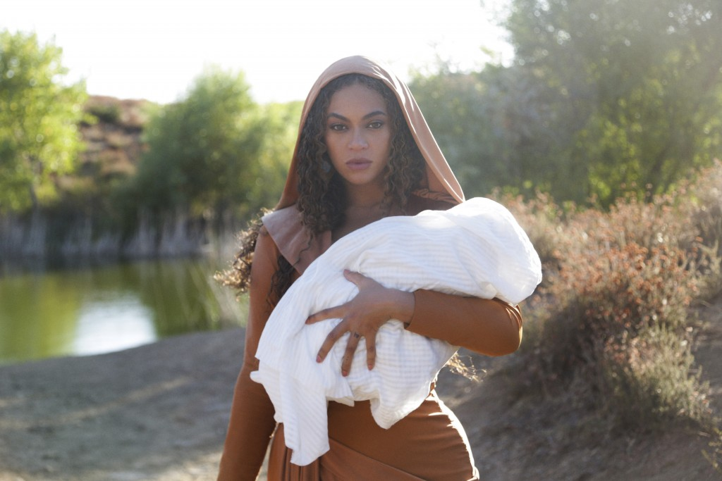 """This image released by Disney Plus shows Beyoncé in a scene from her visual album """"Black is King,"""" premiering Friday on Disney Plus. (Robin Harper/Par..."""