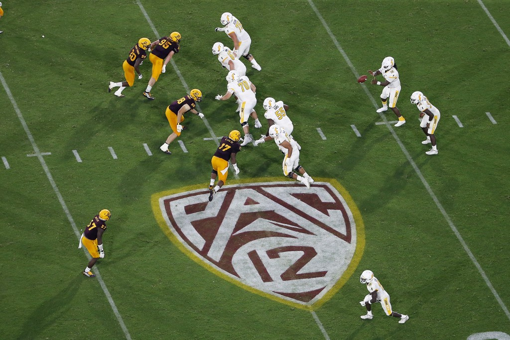 FILE - This Thursday, Aug. 29, 2019, file photo, shows the Pac-12 logo during the second half of an NCAA college football game between Arizona State a...