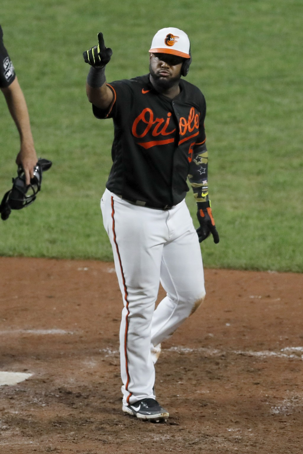 Baltimore Orioles' Hanser Alberto gestures after hitting a solo home run off Tampa Bay Rays relief pitcher Ryan Thompson during the eighth inning of a...