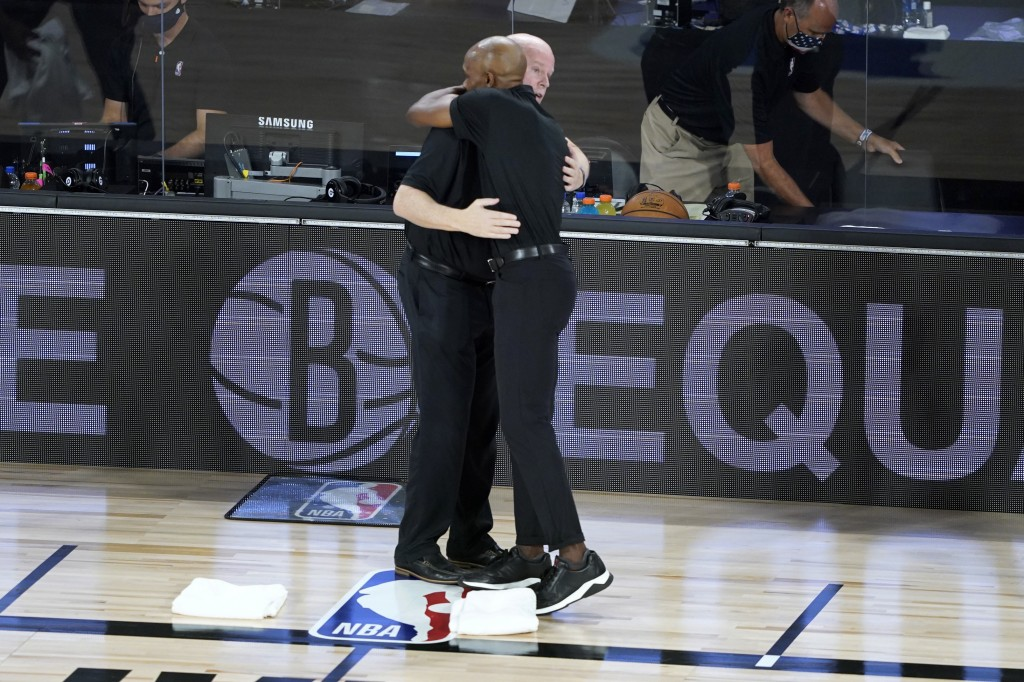 Orlando Magic head coach Steve Clifford, left, and Brooklyn Nets head coach Jacque Vaughn hug before the start of an NBA basketball game Friday, July ...