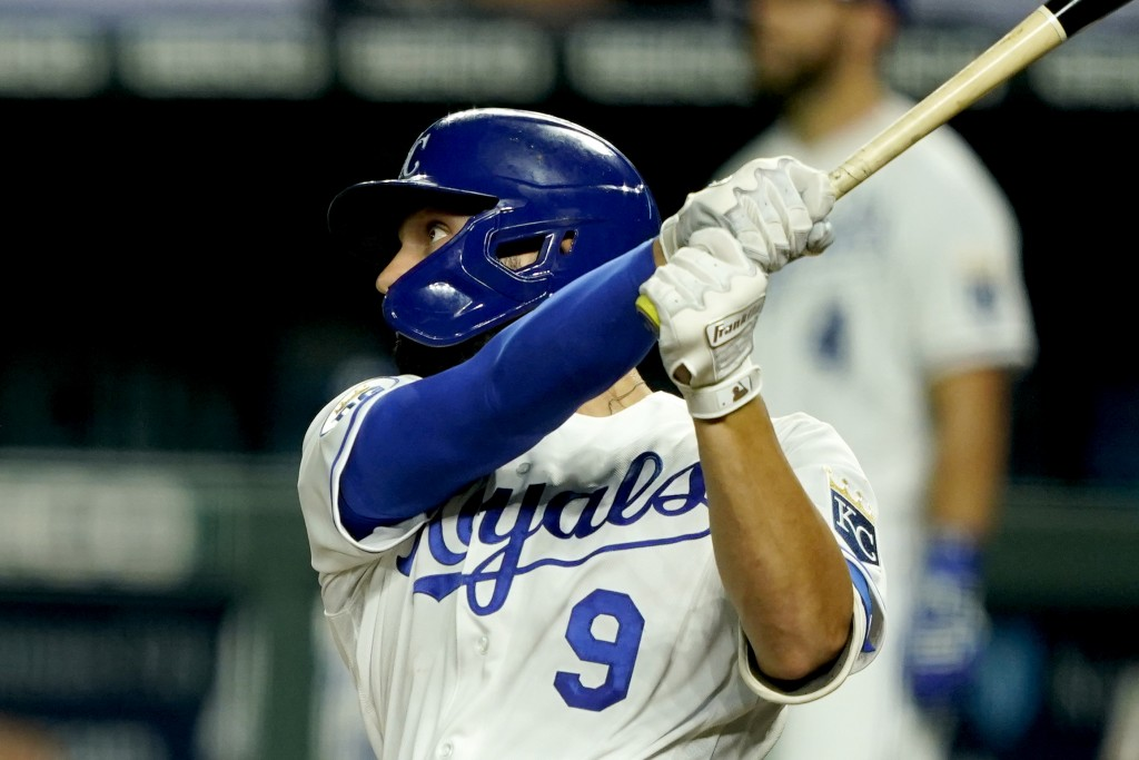 Kansas City Royals' Ryan McBroom hits a solo home run during the sixth inning of a baseball game against the Chicago White Sox Friday, July 31, 2020, ...