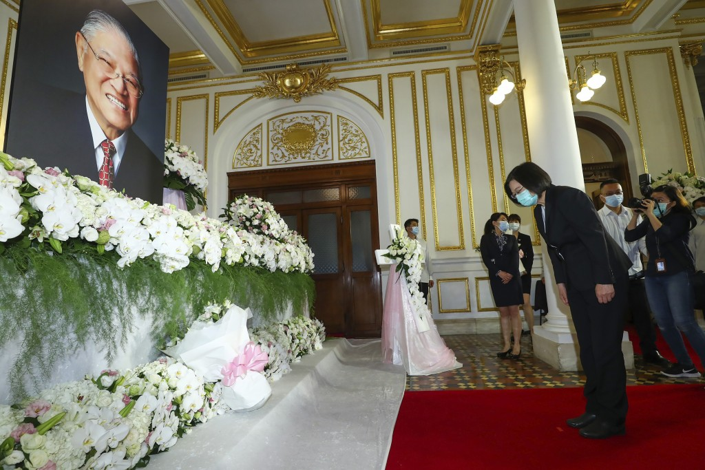 In this photo released by the Taiwan Presidential Office, Taiwan's President Tsai Ing-wen pays her respects at a memorial for former Taiwanese Preside...