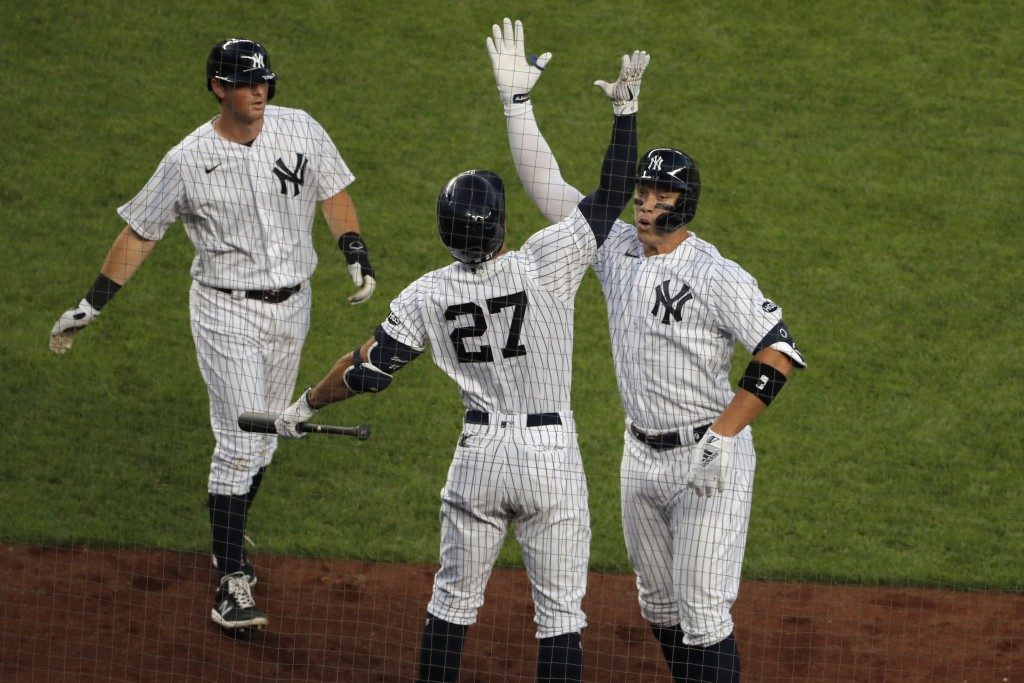 New York Yankees' Aaron Judge, right, celebrates his two-run home run with Giancarlo Stanton (27), center, and DJ LeMahieu during the third inning of ...