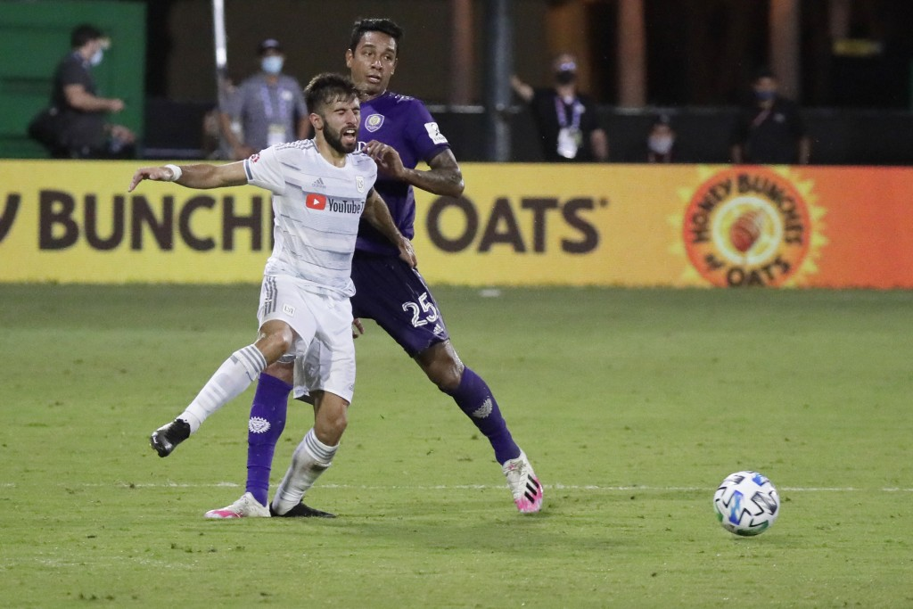 Los Angeles FC forward Diego Rossi (9) battles for the ball with Orlando City defender Antonio Carlos (25) during the second half of an MLS soccer mat...