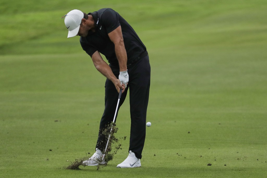 Brooks Koepka hits form the fairway on the 18th hole during the second round of the World Golf Championship-FedEx St. Jude Invitational Friday, July 3...