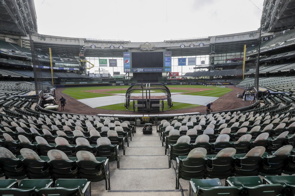 Fan cutouts are seen behind home plate at Miller Park after it was announced that the Milwaukee Brewers home opener was postponed after two St. Louis ...