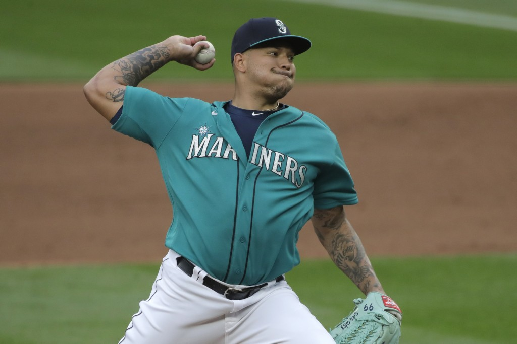Seattle Mariners starting pitcher Taijuan Walker throws against the Oakland Athletics during the fifth inning of a baseball game, Friday, July 31, 202...