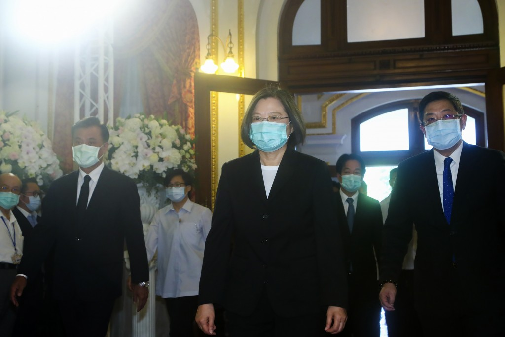 In this photo released by the Taiwan Presidential Office, Taiwan's President Tsai Ing-wen, center, arrives at a memorial for former Taiwanese Presiden...