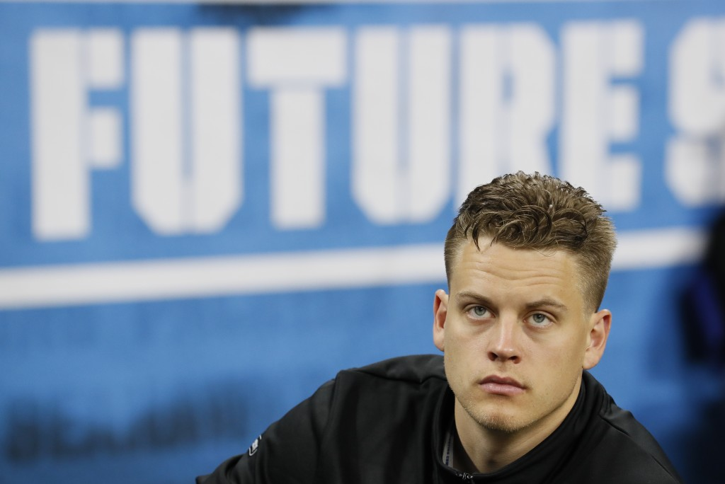 FILE - In this Feb. 27, 2020, file photo, LSU quarterback Joe Burrow watches a drill at the NFL football scouting combine in Indianapolis. No. 1 overa...