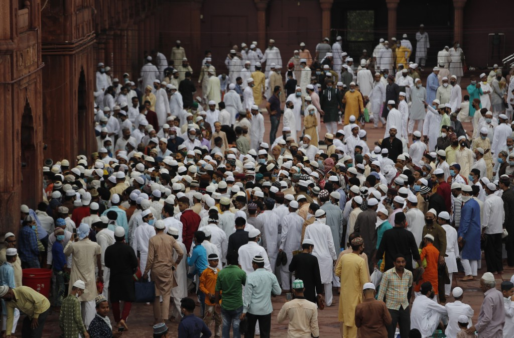 Indian Muslims leave after offering Eid al-Adha prayer from the Jama Masjid in New Delhi, India, Saturday, Aug.1, 2020. Eid al-Adha, or the Feast of t...