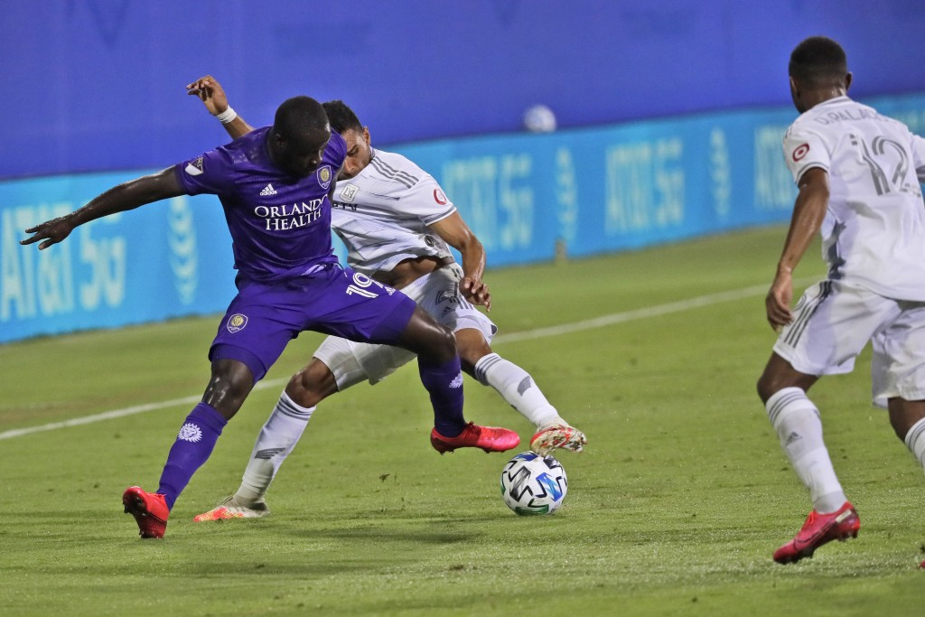 Orlando City forward Benji Michel (19) battles for the ball with Los Angeles FC defender Eddie Segura, left, as Los Angeles FC defender Diego Palacios...