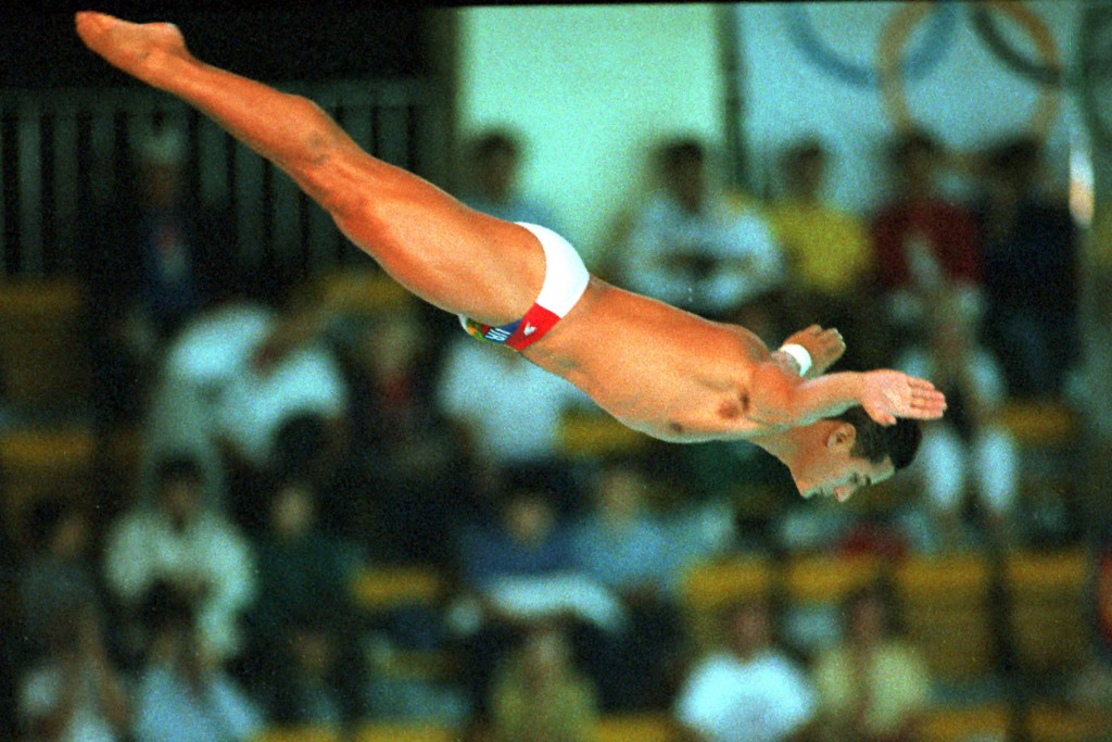 FILE - In this Sept. 26, 1988, file photo, Greg Louganis, of the United States, performs in the men's preliminary 10-meter platform diving competition...