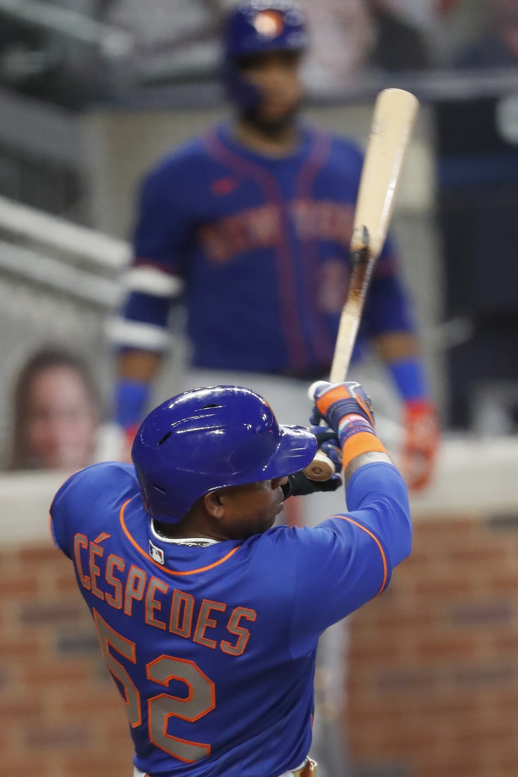 New York Mets' Yoenis Cespedes follows thorough on a two-run double in the fifth inning of a baseball game against the Atlanta Braves Friday, July 31,...