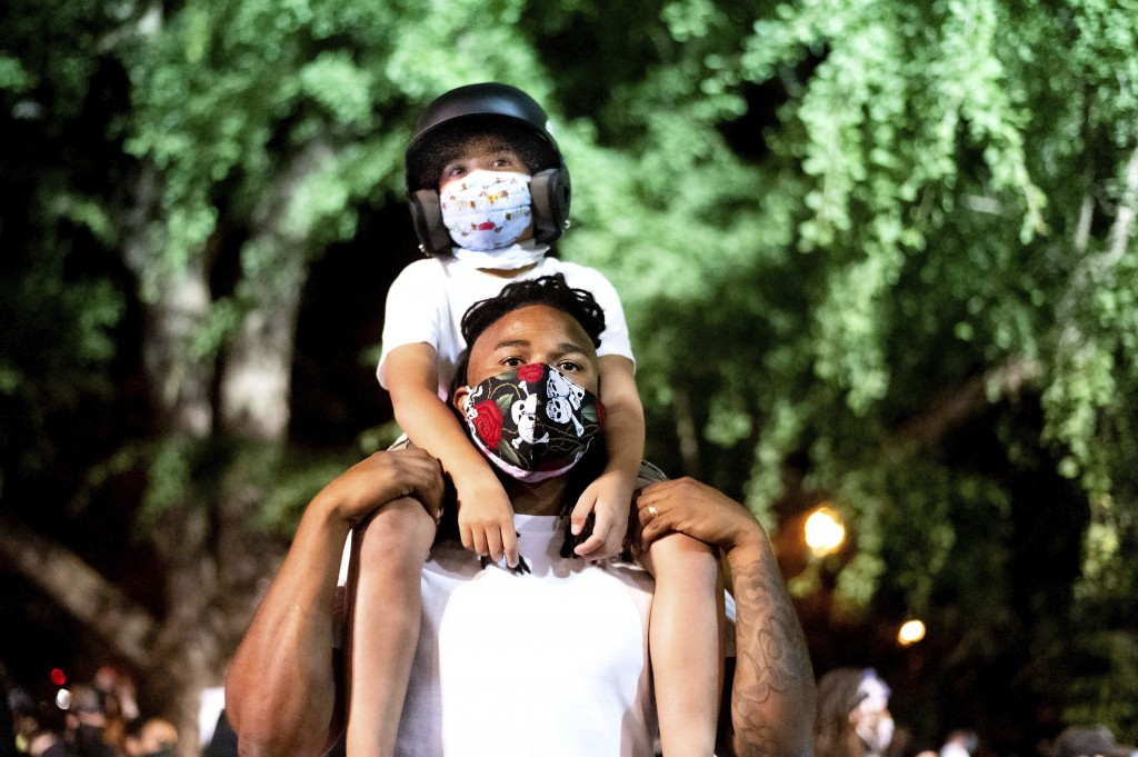 Leshan Terry hold his son Leshan Terry, Jr., 6, during a Black Lives Matter protest at the Mark O. Hatfield United States Courthouse on Friday, July 3...