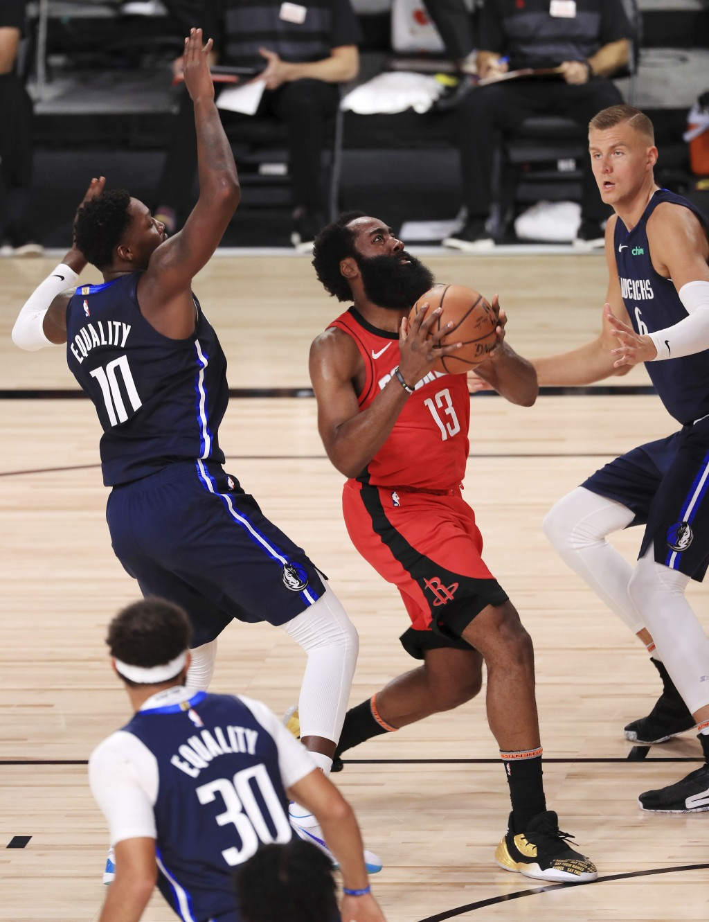 Houston Rockets James Harden (13) drives to the basket against the Dallas Mavericks during the first half of an NBA basketball game Friday, July 31, 2...