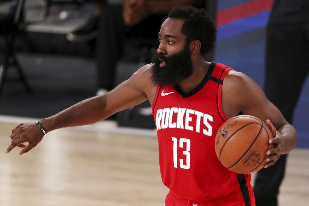 Houston Rockets James Harden (13)  dribbles the ball against the Dallas Mavericks during the second half of an NBA basketball game Friday, July 31, 20...