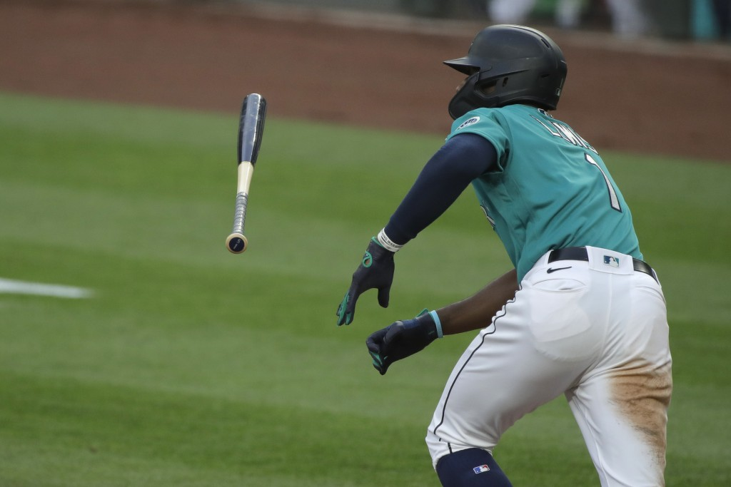Seattle Mariners' Kyle Lewis tosses his bat after hitting a single against the Oakland Athletics during the fifth inning of a baseball game Friday, Ju...